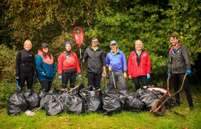 Bottles, mops and wheelbarrows - a team of paddlers clean up Wigan canal